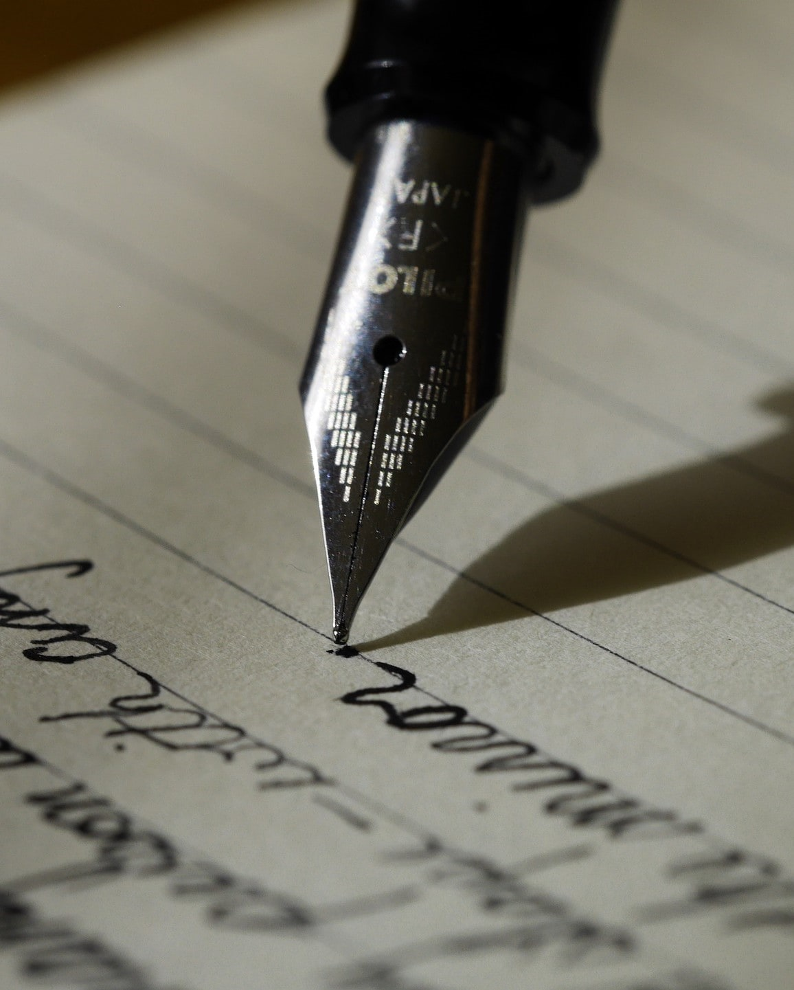 a pen poised over paper